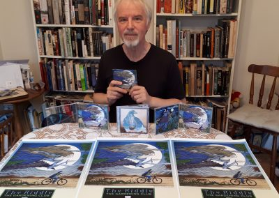 The day I received copies of The Riddle, with the Gonzo Multimedia C D version of the original L P in the centre. Very happy with the sounds and the art. A very long journey!