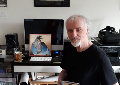 Me holding the newly minted Gonzo Multimedia, Gardening Club C D. With the L P version and original art on the wall.